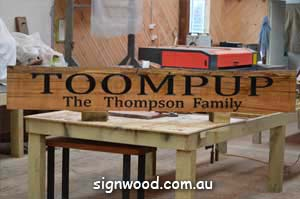 toompup wood sign