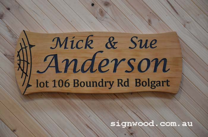 log shaped wood sign