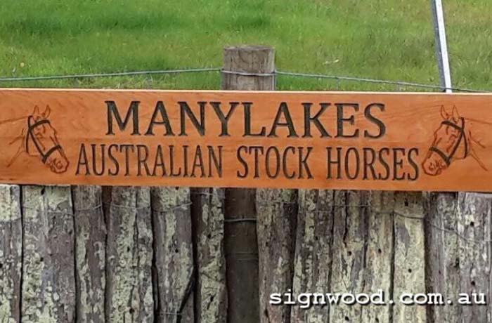 stable and horse wooden fence sign